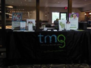 TMG exhibit table