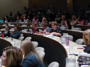 attendees in large conference room